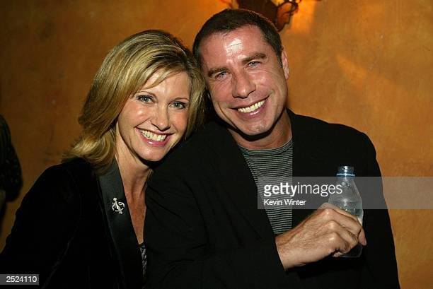 "Olivia Newton-John and John Travolta at ""One World, One Child Benefit Concert"" for the Children's Health Environmental Coalition honoring Meryl..."