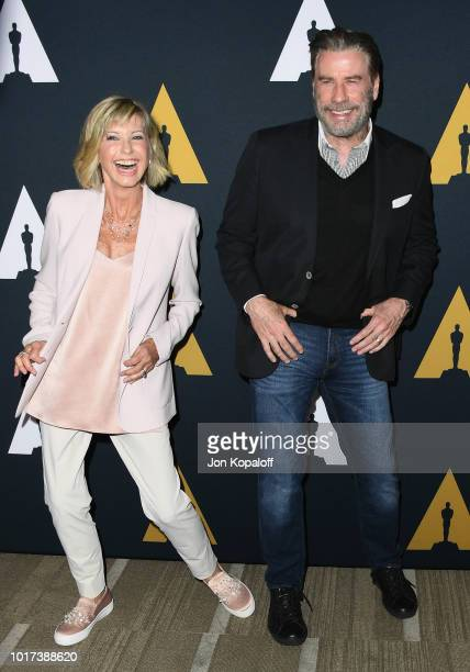 Olivia NewtonJohn and John Travolta attend The Academy Presents Grease 40th Anniversary at Samuel Goldwyn Theater on August 15 2018 in Beverly Hills...
