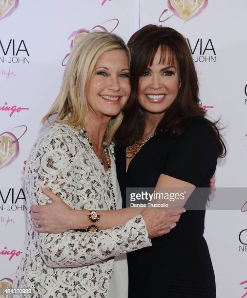 Olivia NewtonJohn and Marie Osmond walk the 'Pink Lady' carpet on the opening of Olivia NewtonJohn's new show 'Summer Nights' at Flamingo Las Vegas...