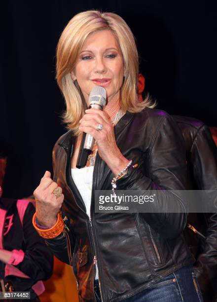 Olivia NewtonJohn during the curtain call at Grease on Broadway to promote Breast Cancer Awareness Month at the Brooks Atkinson Theatre on October 7...