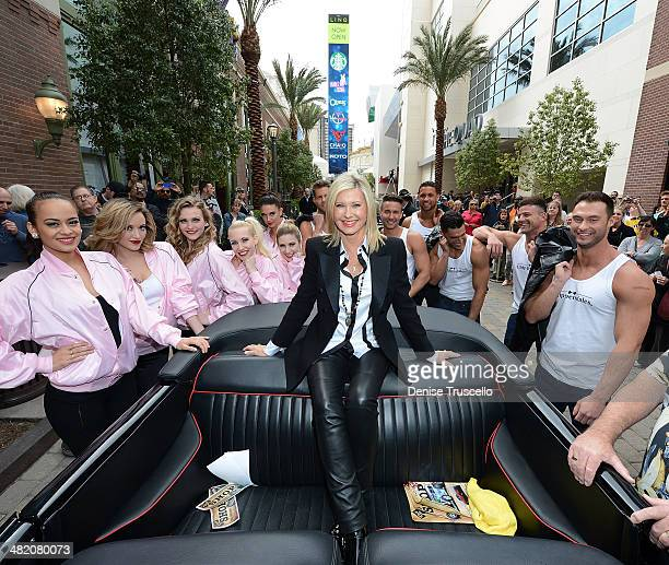 Olivia NewtonJohn is greeted by Las Vegas entertainers from the shows Jubilee and Chippendales during her welcome event to celebrate her residency at...