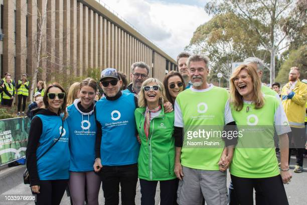 Olivia NewtonJohn John Easterling and Melissa Doyle during the annual Wellness Walk and Research Runon September 16 2018 in Melbourne Australia The...