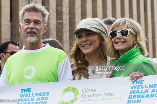 Olivia NewtonJohn John Easterling and Tottie Goldsmith during the annual Wellness Walk and Research Run on September 16 2018 in Melbourne Australia...
