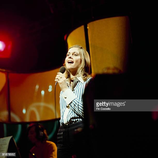 Olivia NewtonJohn performs on stage circa 1973
