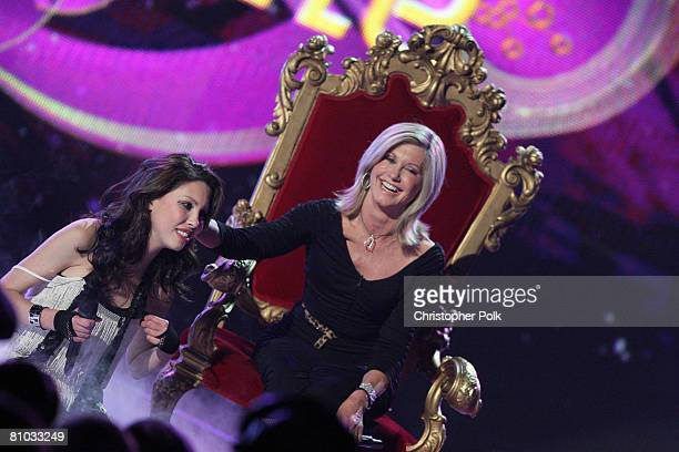 STUDIO CITY CA MAY 08 Olivia NewtonJohn performs with her daughter Chloe Lattanzi during the live taping of the finale of Rock the Cradle on May 8...