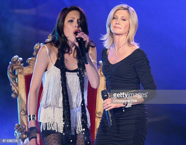 STUDIO CITY CA MAY 08 Olivia NewtonJohn performs with her daughter Chloe Lattanzi during the live taping of the finale of 'Rock the Cradle' on May 8...