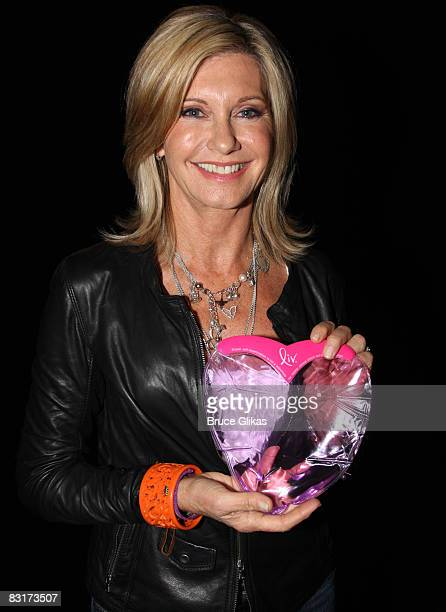 Olivia NewtonJohn poses backstage with her LivKit backstage at Grease to promote Breast Cancer Awareness Month at the Brooks Atkinson Theatre on...