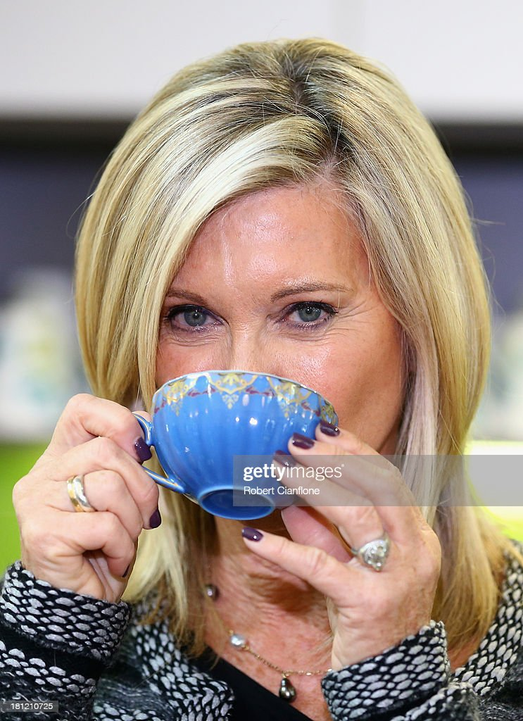 Olivia Newton-John sips a cup of tea after speaking to the media prior to the formal opening of the Olivia Newton John Cancer & Wellness Centre at Austin Hospital on September 20, 2013 in Melbourne, Australia.