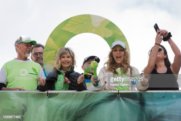 Olivia NewtonJohn Tottie Goldsmith and John Easterling cheering the crowd during the annual Wellness Walk and Research Runon September 16 2018 in...