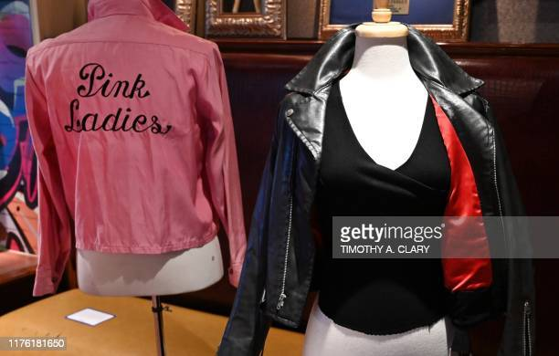 Olivia NewtonJohn's famous black leather jacket worn in the blockbuster film Grease and her Grease Pink Ladies jacket worn in the film are shown...