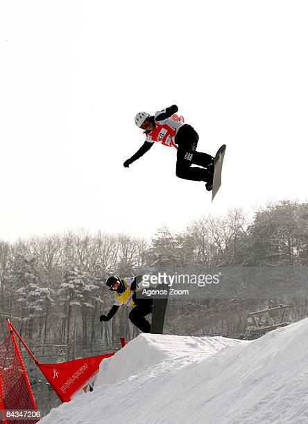 Olivia Nobs of Switzerland and Doriesa Krings of Austria in the Women's Boardercross during the Snowboard FIS World Championship on January 18 2009...