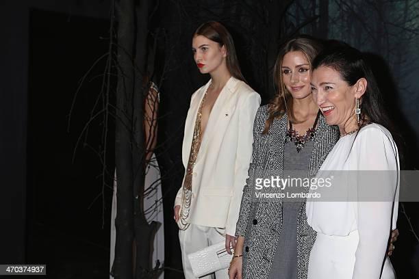 Olivia Palermo and designer Elisabetta Franchi pose at the Elisabetta Franchi Presentation during Milan Fashion Week Womenswear Autumn/Winter 2014 on...