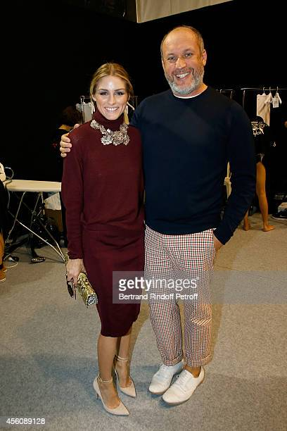 Olivia Palermo and designer Peter Copping pose backstage at the Nina Ricci show as part of the Paris Fashion Week Womenswear Spring/Summer 2015 on...
