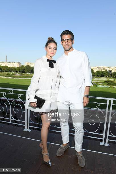 Olivia Palermo and Johannes Huebl attend Miu Miu Club event at Hippodrome d'Auteuil on June 29, 2019 in Paris, France.