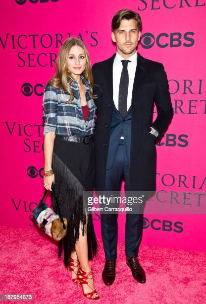 Olivia Palermo and Johannes Huebl attend the 2013 Victoria's Secret Fashion Show at Lexington Avenue Armory on November 13 2013 in New York City