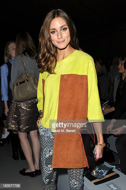 Olivia Palermo attends the front row for the Unique show on day 3 of London Fashion Week Spring/Summer 2013 at TopShop Venue on September 16 2012 in...