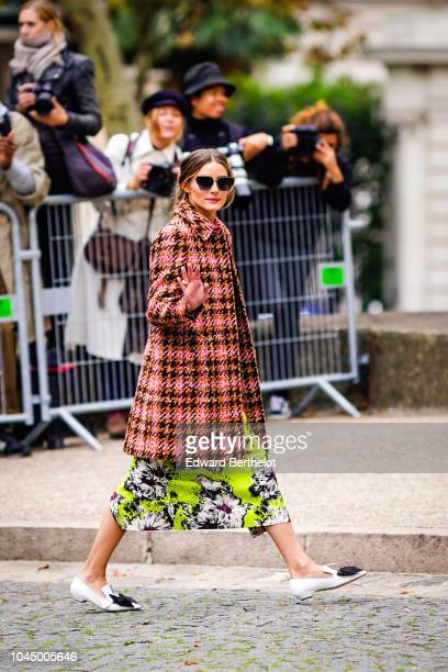 Olivia Palermo in front of photographers outside Miu Miu during Paris Fashion Week Womenswear Spring/Summer 2019 on October 2 2018 in Paris France