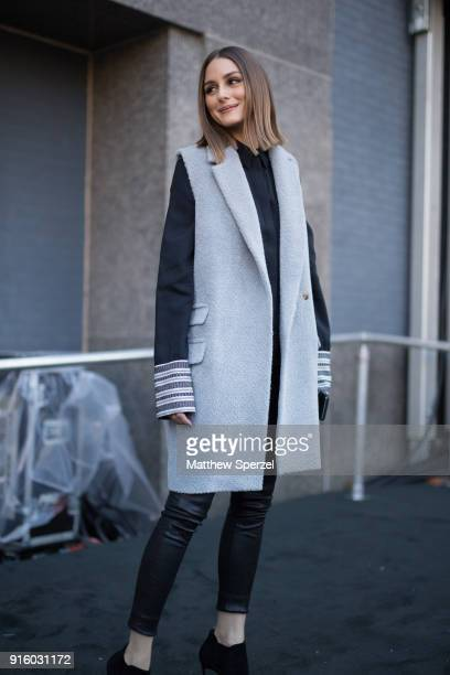 Olivia Palermo is seen on the street attending Colovos and Noon By Noor during New York Fashion Week wearing a long grey wool vest on February 8 2018...