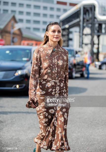 Olivia Palermo is seen wearing brown dress with floral print outside Michael Kors during New York Fashion Week September 2019 on September 11, 2019...
