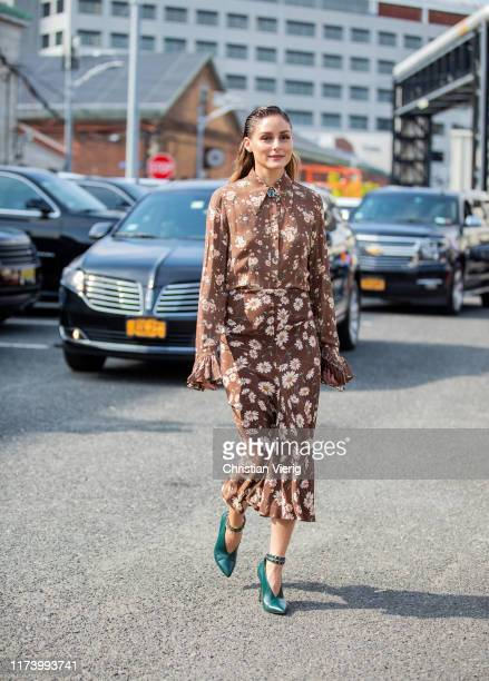 Olivia Palermo is seen wearing brown dress with floral print outside Michael Kors during New York Fashion Week September 2019 on September 11 2019 in...