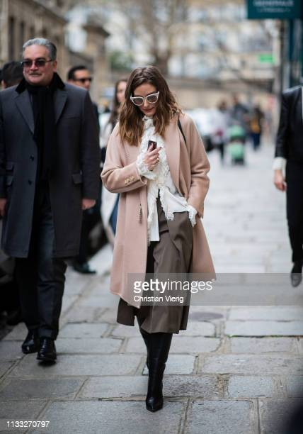 Olivia Palermo is seen wearing coat white blouse outside Elie Saab during Paris Fashion Week Womenswear Fall/Winter 2019/2020 on March 02 2019 in...
