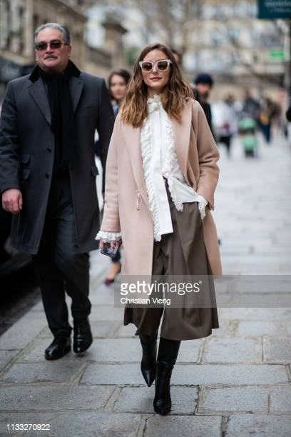 Olivia Palermo is seen wearing coat, white blouse outside Elie Saab during Paris Fashion Week Womenswear Fall/Winter 2019/2020 on March 02, 2019 in...