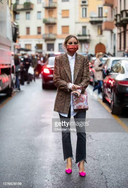 Olivia Palermo is seen wearing face mask, blazer, white button shirt, denim jeans outside Etro during the Milan Women's Fashion Week on September 24,...