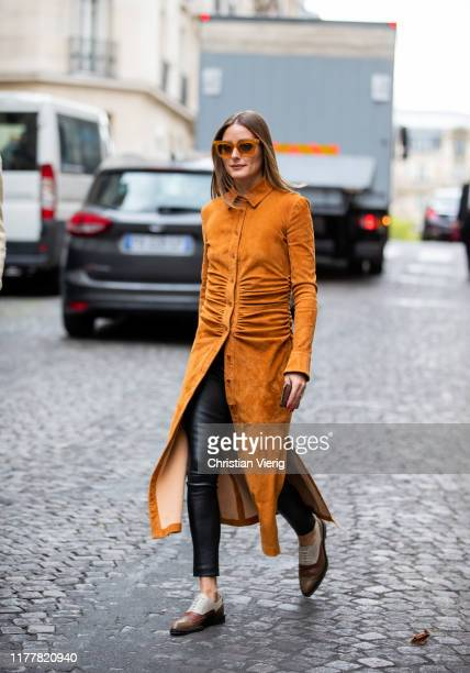 Olivia Palermo is seen wearing orange brown button up dress outside Altuzarra during Paris Fashion Week Womenswear Spring Summer 2020 on September...