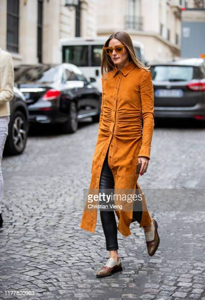 Olivia Palermo is seen wearing orange brown button up dress outside Altuzarra during Paris Fashion Week Womenswear Spring Summer 2020 on September 28...