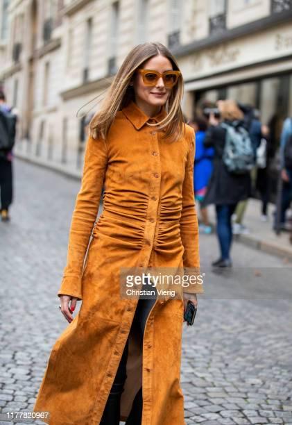 Olivia Palermo is seen wearing orange brown button up dress outside Altuzarra during Paris Fashion Week Womenswear Spring Summer 2020 on September...