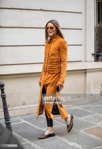 Olivia Palermo is seen wearing orange brown button up dress outside Altuzarra during Paris Fashion Week Womenswear Spring Summer 2020 on September 28...