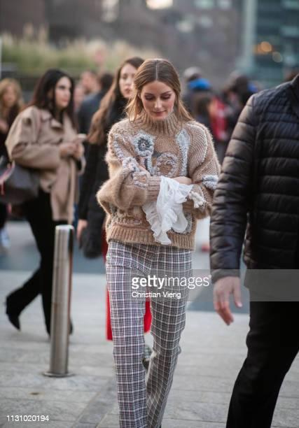 Olivia Palermo is seen wearing plaid pants beige knit outside Alberta Ferretti on Day 1 Milan Fashion Week Autumn/Winter 2019/20 on February 20 2019...