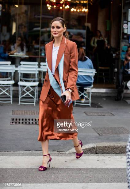 Olivia Palermo is seen wearing rusty brown silk skirt, turquois scarf, blazer, purple heels, white shirt outside the Max Mara show during Milan...