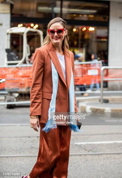 Olivia Palermo is seen wearing rusty brown silk skirt turquois scarf blazer purple heels white shirt outside the Max Mara show during Milan Fashion...