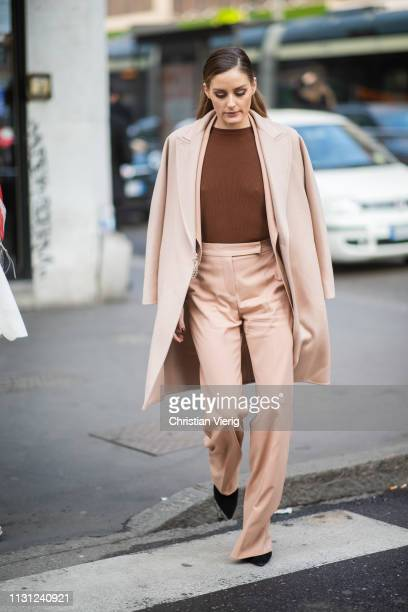 Olivia Palermo is seen wearing suit, coat, brown top outside Max Mara on Day 2 Milan Fashion Week Autumn/Winter 2019/20 on February 21, 2019 in...