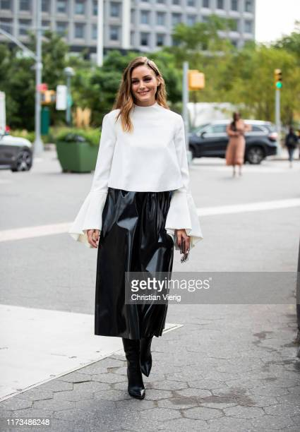 Olivia Palermo is seen wearing white top, black skirt outside Carolina Herrera during New York Fashion Week September 2019 on September 09, 2019 in...