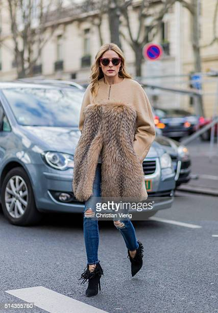 Olivia Palermo is wearing a beige fur coat navy ripped jeans outside Ellery during the Paris Fashion Week Womenswear Fall/Winter 2016/2017 on March 8...