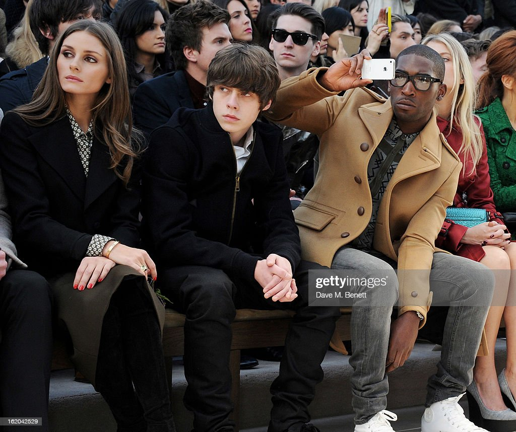 Olivia Palermo, Jake Bugg and Tinie Tempah sit in the front row for the Burberry Prorsum Autumn Winter 2013 Womenswear Show at Kensington Gardens on February 18, 2013 in London, England.