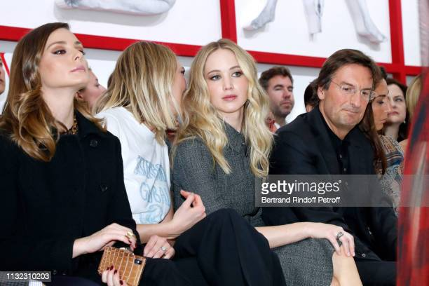 Olivia Palermo Karlie Kloss Jennifer Lawrence and CEO of Dior Pietro Beccari attend the Christian Dior show as part of the Paris Fashion Week...