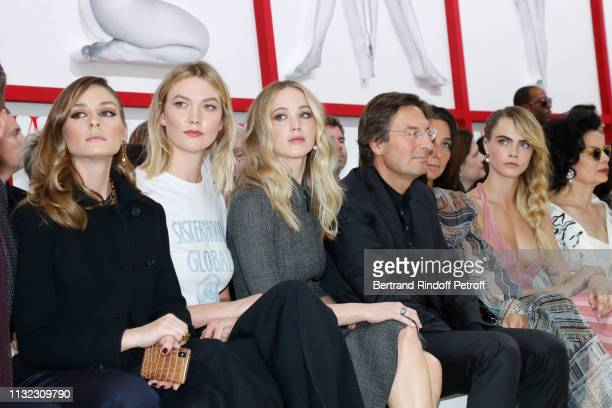 Olivia Palermo Karlie Kloss Jennifer Lawrence CEO of Dior Pietro Beccari his wife Elisabetta Beccari Cara Delevingne and Bianca Jagger attend the...