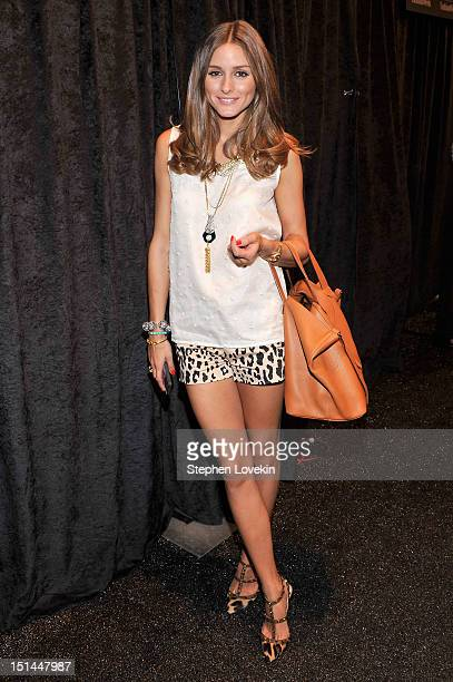 Olivia Palermo poses backstage at the Noon By Noor Spring 2013 fashion show during Mercedes-Benz Fashion Week at The Studio at Lincoln Center on...