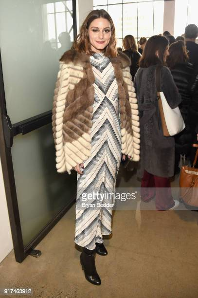 Olivia Palermo poses for a photo outside of the Zimmermann fashion show in Gallery I during IMG NYFW The Shows at Spring Studios on February 12 2018...