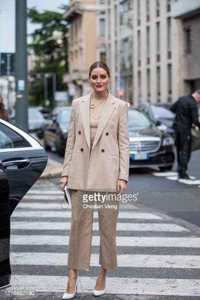Olivia Palermo seen wearing beige turtleneck, blazer and pants, white heels, necklace outside Boss during the Milan Women's Fashion Week on September...