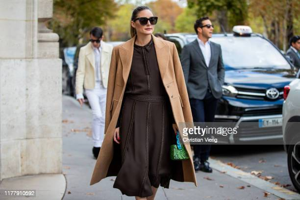 Olivia Palermo seen wearing brown dress with slit, beige wool coat outside Elie Saab during Paris Fashion Week Womenswear Spring Summer 2020 on...