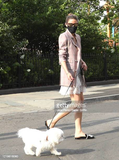 Olivia Palermo takes her dog Mr. Butler on a walk for his 15th birthday on June 12, 2020 in New York City.