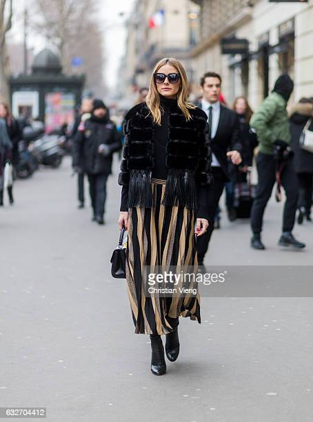 Olivia Palermo wearing a black fur jacket striped skirt outside Elie Saab on January 25 2017 in Paris Canada