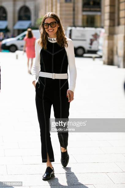 Olivia Palermo, wearing a black Karl Lagerfeld jumpsuit, is seen outside Dondup show during Paris Fashion Week - Haute Couture Fall Winter 2019 -...