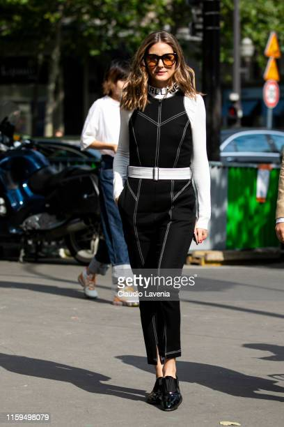 Olivia Palermo wearing a black Karl Lagerfeld jumpsuit is seen outside Schiaparelli show during Paris Fashion Week Haute Couture Fall Winter 2019...