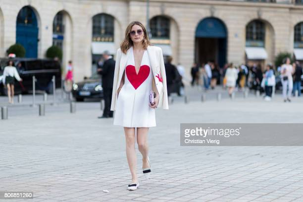 Olivia Palermo wearing a dress with hear print outside Schiaparelli during Paris Fashion Week Haute Couture Fall/Winter 20172018 Day Two on July 3...