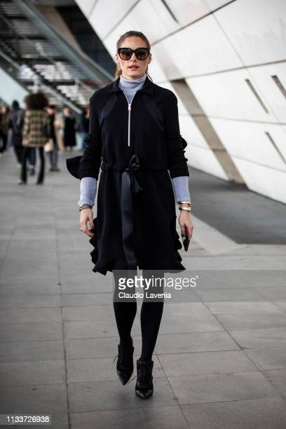 Olivia Palermo, wearing a light blue turtleneck sweater, black decorated coat and black heels, is seen outside Giambattista Valli on Day 8 Paris...
